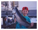 Young man with large fish caught with Capt. John Wagner aboard the Playin' Hooky Charter boat off Chicago